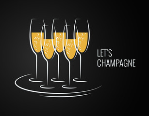 champagne glass on a tray on black background