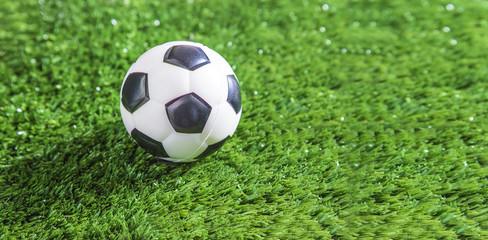 Football ball on green football field