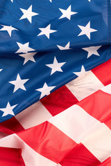 American flag close up. Stars and stripes satin flag background. USA flag wallpaper.