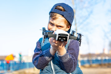 Boy plays with his quadrocopter