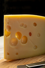 Dutch hard cheese Maasdam or Emmentaler, cheese with holes