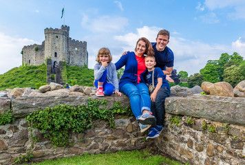 Family visiting Cardiff castle in Wales, UK
