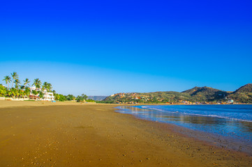 Beautiful outdoor view of empty blue water beach in San Juan del sur in south Nicaragua