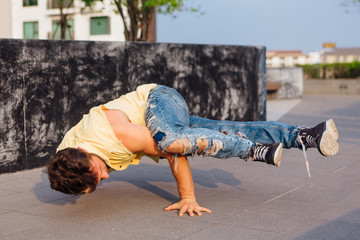 Young man dancing breakdance on the street