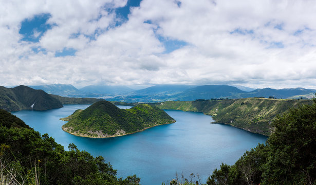 Panoramic of Cuicocha, beautiful blue lagoon inside the crater of Cotacachi volcano near Otavalo