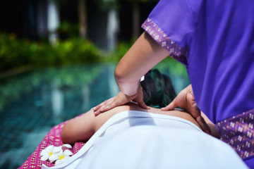 Close up hands doing back massage in spa