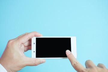 Using mobile phones in business scene..  スマートフォンを使う 水色背景