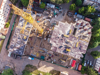 construction site with yellow tower crane shot from above. aerial photo