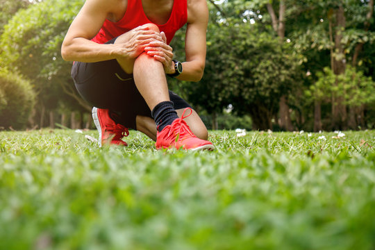 Athletic man with leg and knee pain. Sports exercising injury. Health care concept.