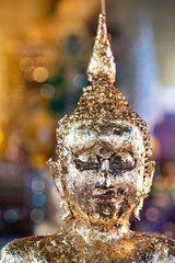 Buddha statue with gold covered