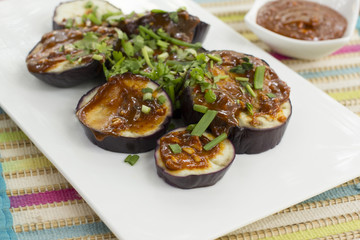 Steamed eggplants with spicy peanut sauce is a easy and tasty and easy recipes. Roundels of eggplants are steamed and accompanied with peanut sauce.