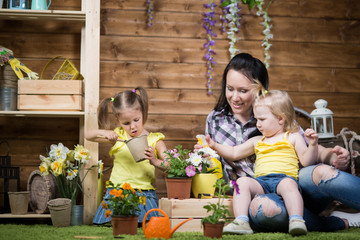 Mom and children are planting flowers