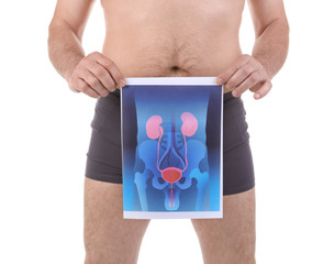 Mature man holding picture of urinary system on white background