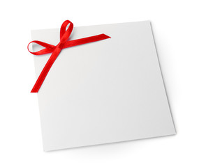 Blank gift tag with satin ribbon on white background