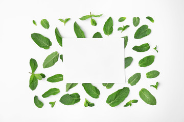 Flat lay composition with fresh green mint leaves on white background