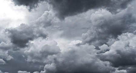 Dark storm clouds before rain for climate background. Clouds become dark gray before raining. Abstract dramatic background.