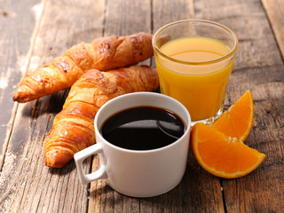 coffee cup with croissant and orange juice
