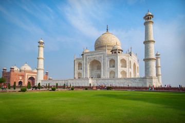 Taj Mahal on a sunny day. An ivory-white marble mausoleum on the south bank of the Yamuna river in Agra, Uttar Pradesh, India. One of the seven wonders of the world.