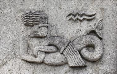 Zodiac - Aquarius or Water-bearer, a stone relief