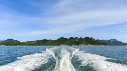 Wave of trace tail of speed boat on water surface.