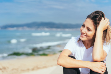 Smiling happy relaxed woman at the beachfront