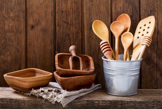 kitchen utensils on wooden shelf