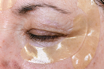 Portrait of mature woman with rejuvenation mask on face