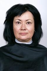 Portrait of mature woman without makeup. Brunette. Middle age
