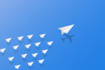 Leadership, teamwork and courage concept, White paper planes with shadow flying on sky.