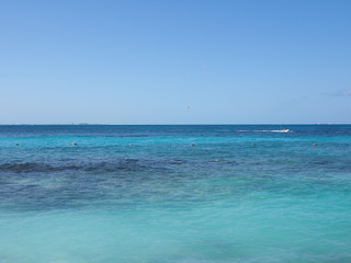Wonderful seascape panorama of turquoise waters of Caribbean Sea landscape with horizon line at Cancun city in Mexico