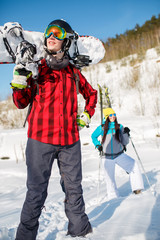 Image of young man wearing helmet with snowboard