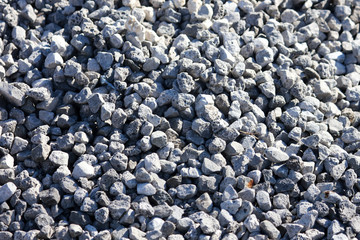 Stone crushed stone on the construction site as an abstract background