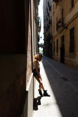 Trendy woman having fun on street