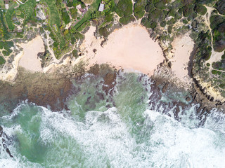 Wall Mural - Aerial view of exotic sandy beach and ocean with clear turquoise water.