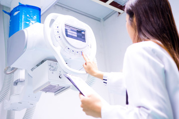 Smart doctor with CT scan machine in lab.