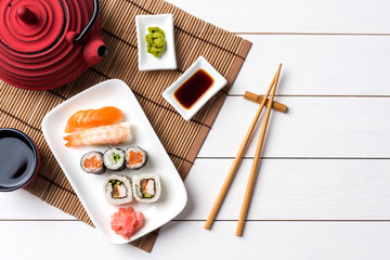 Printed roller blinds Sushi bar Set of sushi with red teapot and chopsticks. Top view