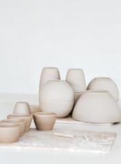 Handmade ceramic tableware, sunlight, white background