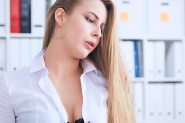 Fototapeta Sexy secretary undresses in office, flirt and desire. Office provocation. obraz
