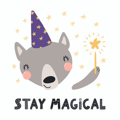 Hand drawn vector illustration of a cute funny wolf in a wizard hat, holding magic wand, with lettering quote Stay magical. Isolated objects. Scandinavian style flat design. Concept for children print
