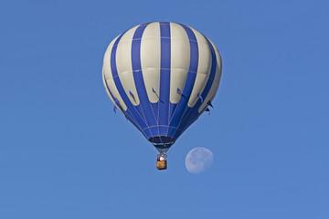 Balloon ride towards the morning moon