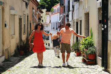 Lisbon Portugal, a young family walks through the old town