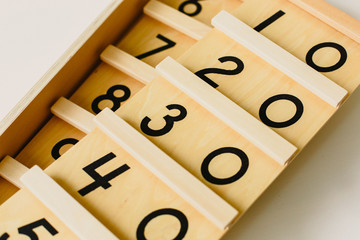Wood montessori material, class at school with math bars