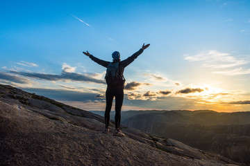Woman successful hiking silhouette in mountains, motivation and inspiration in sunset