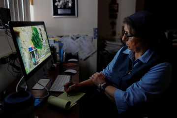 Sister Rose Pacatte, a Catholic nun who reviews movies,  is shown in her office in this picture taken May 24, 2018 in Culver City, California