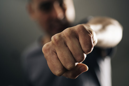 young man throwing a punch.