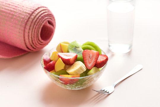 Pink yoga mat and Fruit Salad
