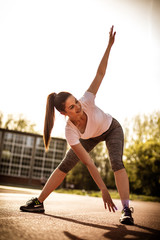 Pilates exercise outside. Young woman exercise.