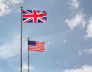 British and American flags flying on a sunny day