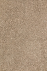Brown concrete floor texture. Close-up photo of scabrous background. Vertical orientation