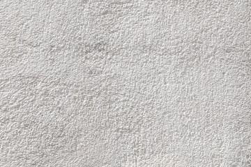 White cement wall texture. Close-up of concrete background with grain